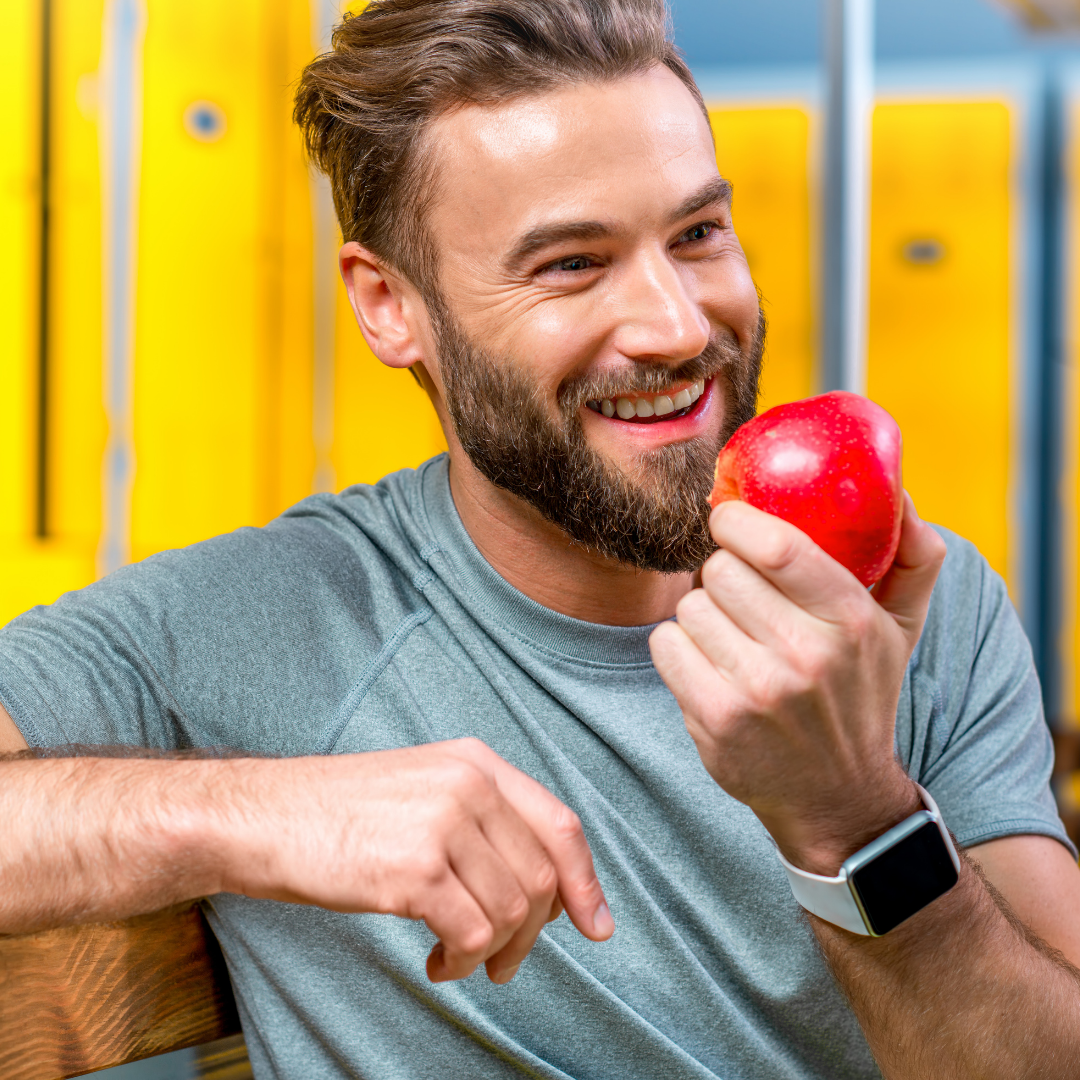 Man eating apple. Snacking smart for oral health.
