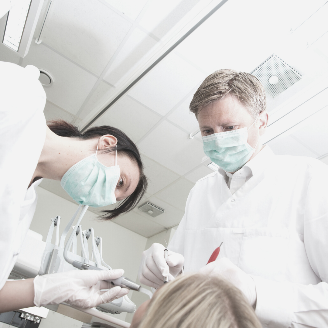 A dental surgeon is performing orthognathic surgery.